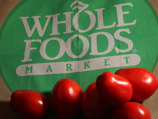 This July 29, 2013 file photo shows produce on a Whole Foods paper bag in Andover, Mass.
