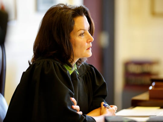 Judge Leslie Ghiz presides over a pretrial hearing,