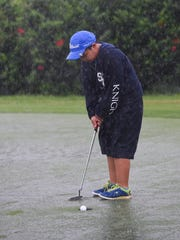 Danny Zheng, 8, makes the putt during the 7th Annual
