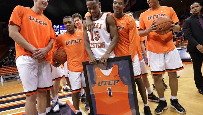 UTEP's lone senior Dominic Artis is surrounded by teammates before their final regular season game Saturday against Charlotte.