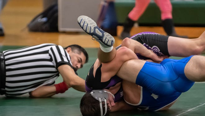 Lakeview's Nicholas Saumier wins by pin over Harper Creek's Gavin Tooman in the 160 pound weight class during the All City Meet at Pennfield Wednesday eveing.