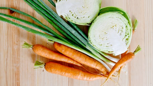 Carrots, scallions and cabbage, part of a CSA share