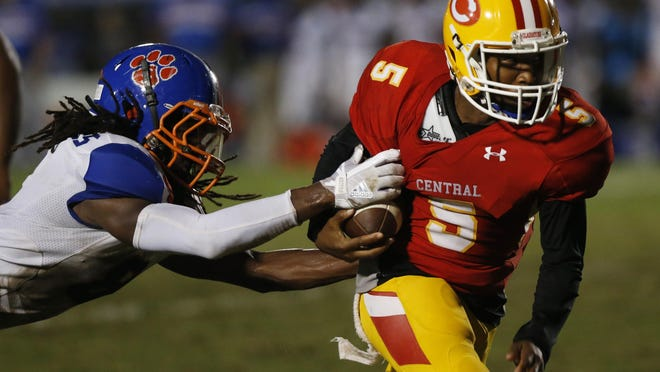 Clarke Central's Tyreke Lumpkin (5) breaks a tackle from Cedar Shoal's Jamal Boyd (8) during a GHSA high school football game between Clarke Central and Cedar Shoals in Athens, Ga., on Friday, Sept. 28, 2018.