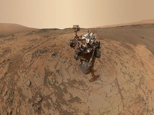 """In this handout provided by NASA/JPL-Caltech/MSSS This self-portrait of NASA's Curiosity Mars rover shows the vehicle at the """"Mojave"""" site, where its drill collected the mission's second taste of Mount Sharp. The scene combines dozens of images taken during January 2015 by the MAHLI camera at the end of the rover's robotic arm."""