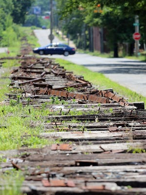 Railroad ties lay disassembled along Morgan Street in Shelby. The ties are being removed for the future rail trail.