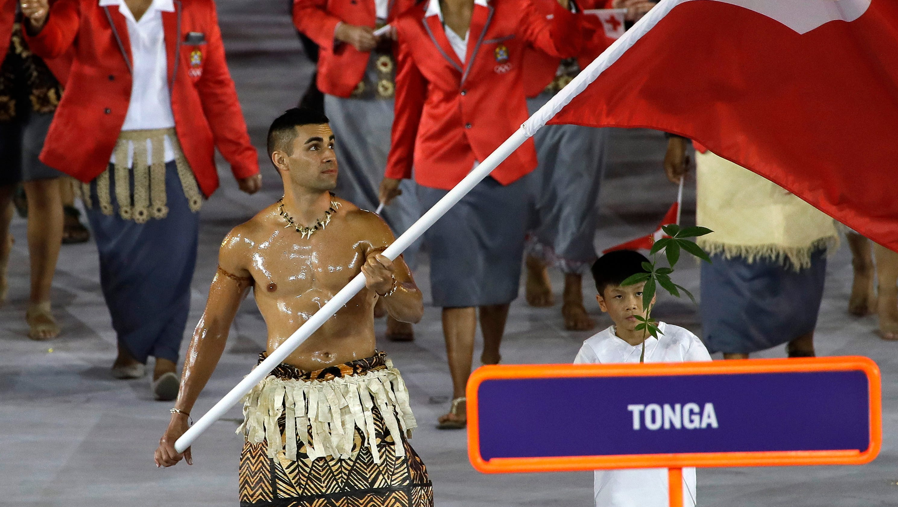 introducing the tonga flagbearer who glistened during rio. Black Bedroom Furniture Sets. Home Design Ideas
