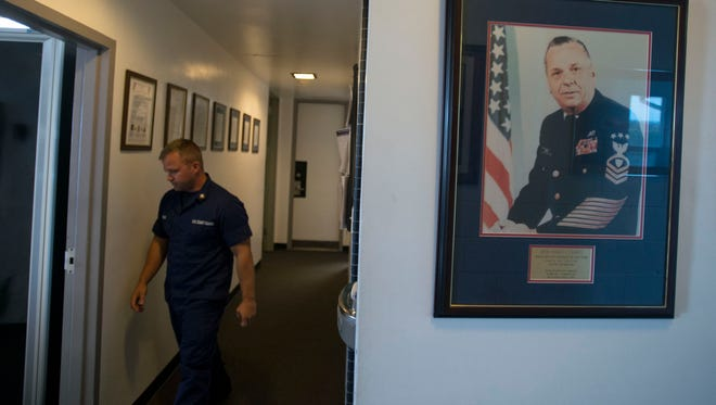 Petty officer 2nd class E5 Peter Tomlin heads to the front desk of United States Coast Guard Station Ocean City.