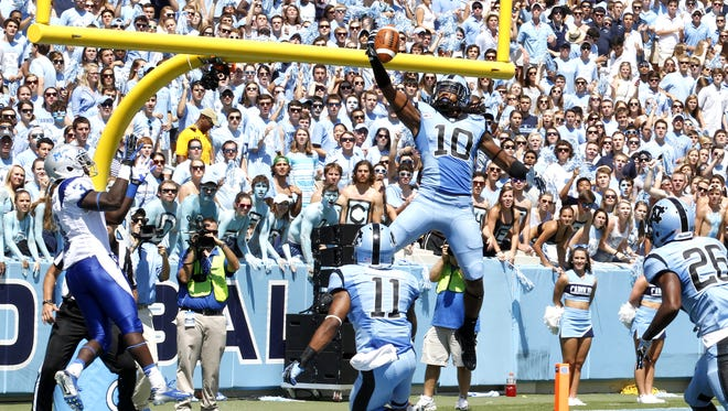 North Fort Myers graduate Tre Boston (10) picks off a pass for North Carolina against Middle Tennessee in the second game of the 2013 season. Boston had four interceptions and led the Tar Heels with 85 tackles for the season.