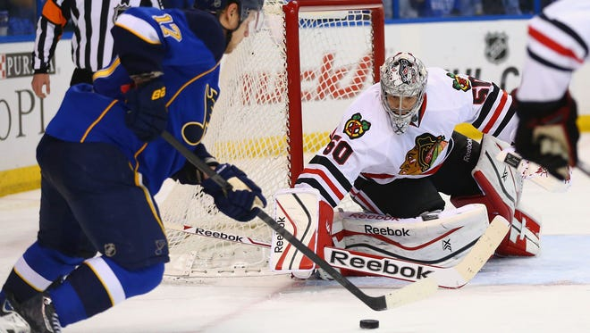 Corey Crawford #50 of the Chicago Blackhawks makes a save against the St. Louis Blues in Game One of the First Round of the 2014 Stanley Cup Playoffs at the Scottrade Center on April 17, 2014 in St. Louis, Missouri.