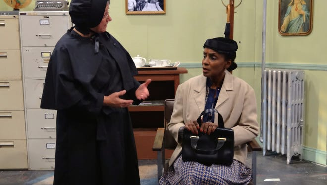 """Julie Eads Woolley as Sister Aloysius, left, and Nancy Nelson-Ewing as Mrs. Muller are shown in a scene from County Players production of """"Doubt."""""""