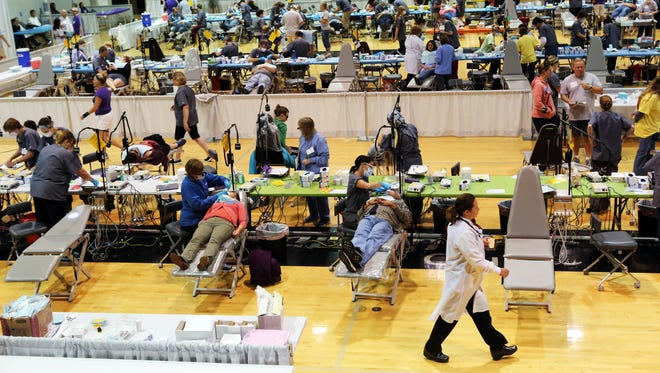 Hundreds of people waited in line for up to 24 hours to receive free dental care at the Mission of Mercy dental clinic set up at Chemeketa Community College.