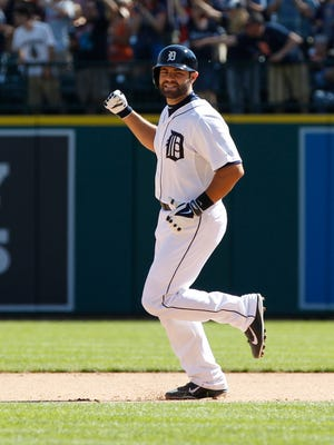 Detroit Tigers catcher Alex Avila starts celebrating after he hit walkoff single against the New York Yankees in Detroit on Aug. 28, 2014.