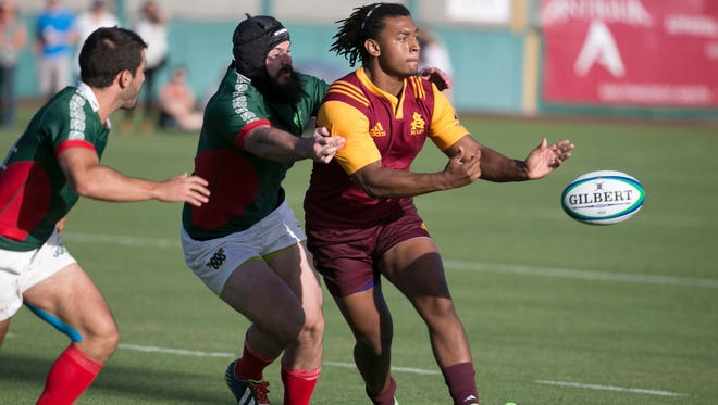 ASU's Pete Akele-Ale tosses the ball to a teammate while under pressure from Mexican National team defenders during the Fiesta Bowl Rugby Classic at Scottsdale Stadium on April 23, 2016 in Scottsdale, Ariz.
