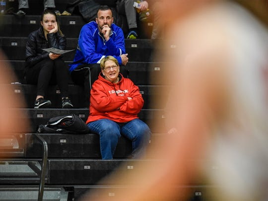 Dawn Schenk  watches from the stands during a St. Cloud State University basketball game Wednesday, Feb. 21, at Halenbeck Hall in St. Cloud.
