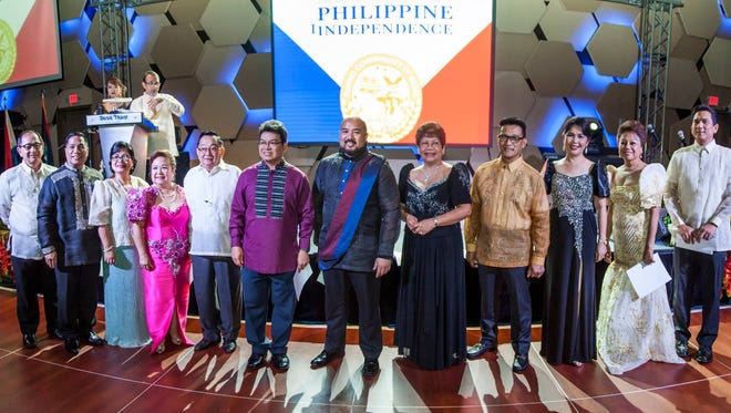 The Filipino Community of Guam's 2017-2018 Executive Board was sworn into office by Philippine Consul General Marciano de Borja on June 16, 2017 at the Philippine Independence Ball at the Dusit Thani Guam Resort. L to R: James Robinson, 1st vice president, Pat Luces, 2nd vice president, Lynda Caasi, 3rd vice president, Edna Rebanal, treasurer, Clarito Viray, assistant treasurer, de Borja, Norman Analista, president, Nilfa Milan, assistant secretary, Franc Huelar, auditor, Loisa Cabuhat, public relations officer, Annabelle Dancel, peace officer, Noly Caluag, peace officer. Not pictured is Kaye Custodio, secretary.