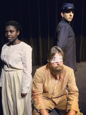 "(Left to right) Marie Baptiste, Jordan Wilson and Michael J. Pineda star in Theatre Conspiracy's ""The Cave."""