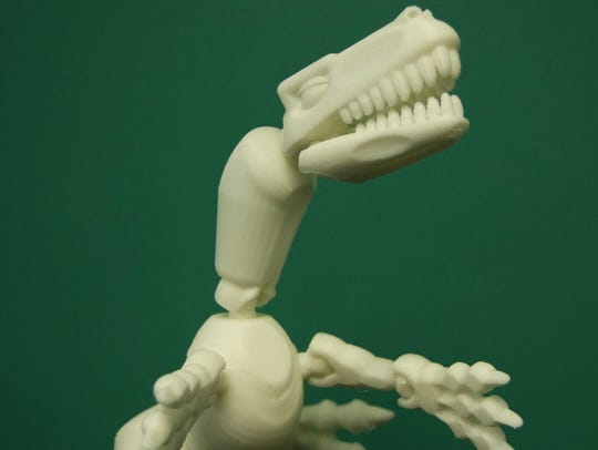 A dinosaur created by IMAG's new 3-D printer, part