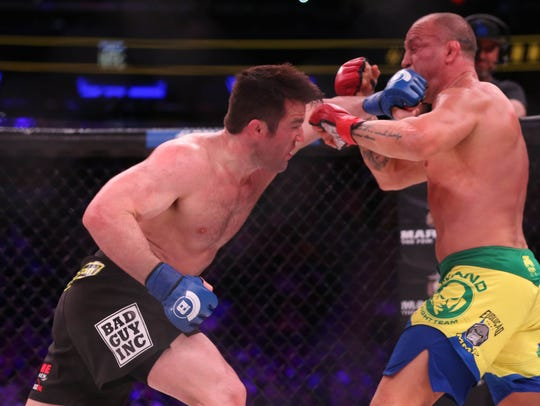 Chael Sonnen connects with a strike against Wanderlei