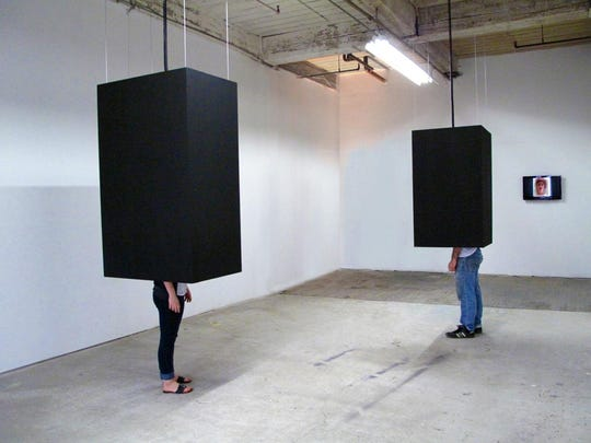 """""""Isolation Theaters,"""" installations by Lynn Herring for Shirt Factory shows. People """"crawl up into them and there are videos playing inside of each one,"""" she said."""