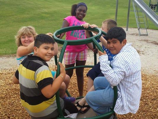 Parkside kids on playgr.jpg