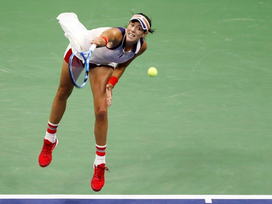 Garbine Muguruza, of Spain, serves against Petra Kvitova, of the Czech Republic, during the fourth round of the U.S. Open tennis tournament, Sunday, Sept. 3, 2017. (AP Photo/Adam Hunger)