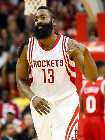 Rockets shooting guard James Harden reacts after a
