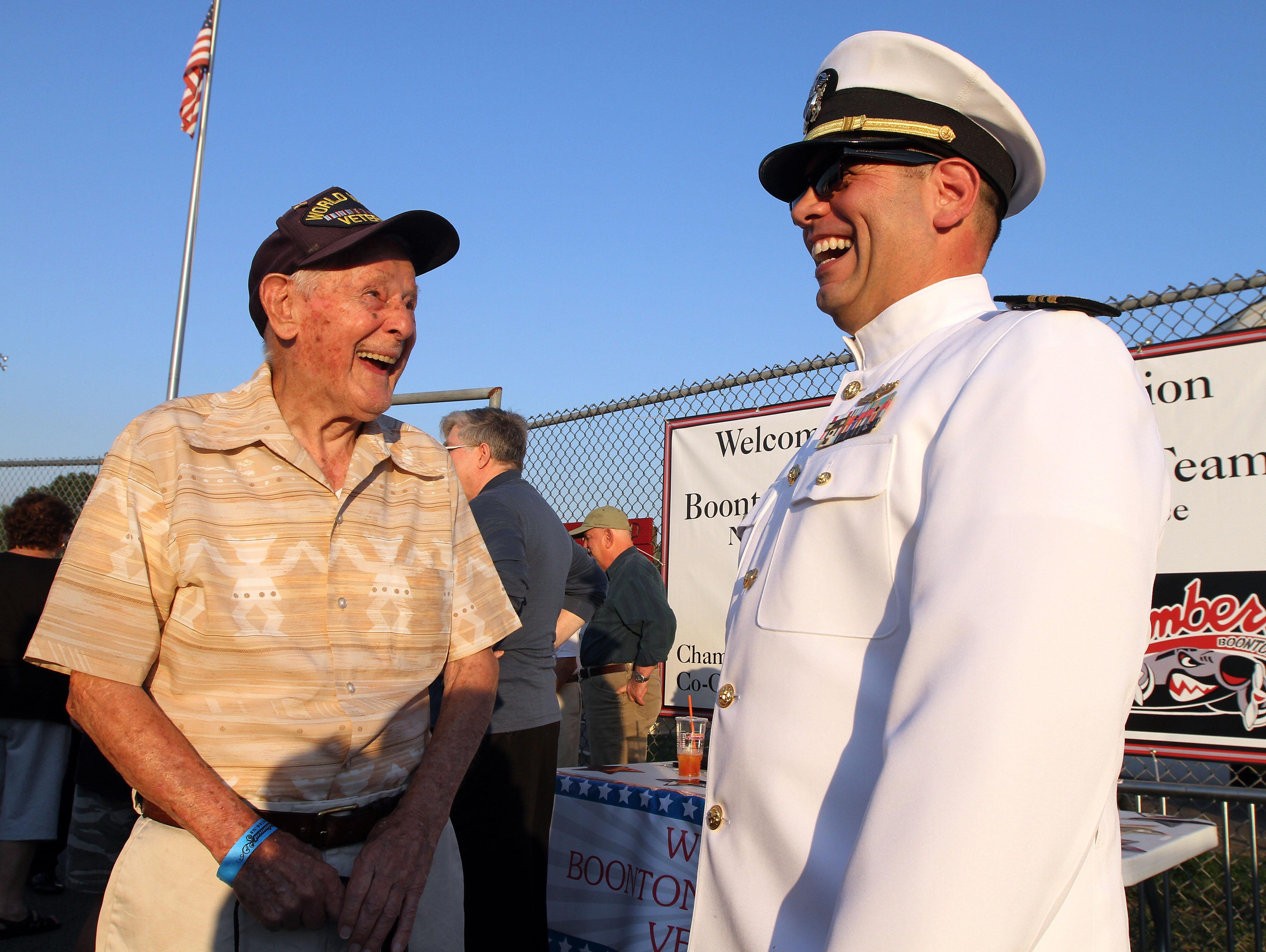 98-year-old World War II Air Force Veteran Steve Bolcar and Navy LCDR. Dennis Maida share a laugh before the Boonton vs Pequannock Friday night football matchup. Boonton High School honored its graduate military veterans during halftime.