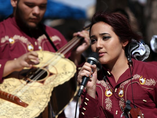 Isabelle Olivas, of Mariachi Encanto, sings a traditional Mexican ballad in the Columbus Plaza.