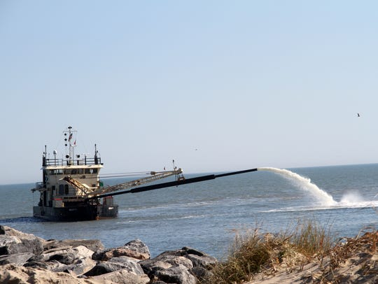 The dredge Currituck is seen dredging Rudee Inlet in