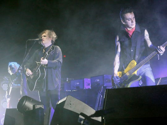 The Cure lead singer and songwriter Robert Smith, left, and bass guitarist Simon Gallup perform in front of a sold-out crowd and the Don Haskins Center on Tuesday.