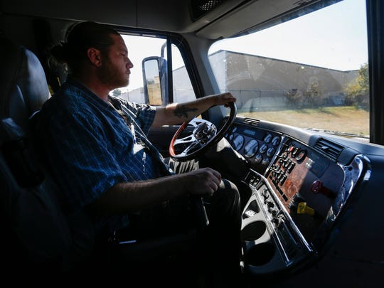 Eric Jones, an instructor at Specialized Driver Training, sits in the cab of a truck at the school. Students are being taught how to recognize and report sex trafficking while on the road.