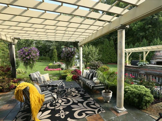 Gino and Tracy Villani added an extensive outdoor living space to their Greenfield home.
