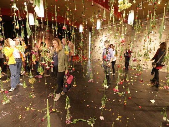 """Visitors experience Autumn Keller's """"raining garden"""""""