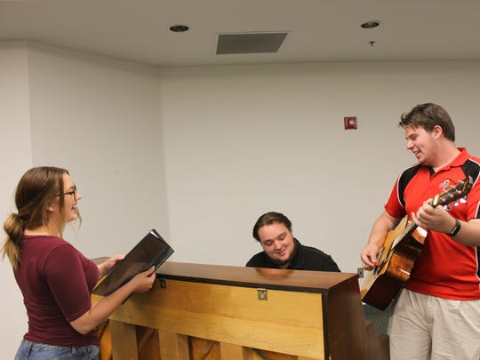 "Jordyn Aspyn as Janine, Brandon Grayson as Norm and Sean Militscher as Chet rehearse a scene from the Neil Simon Festival's 2017 production of ""Under Construction: The Blue Collar Musical."""