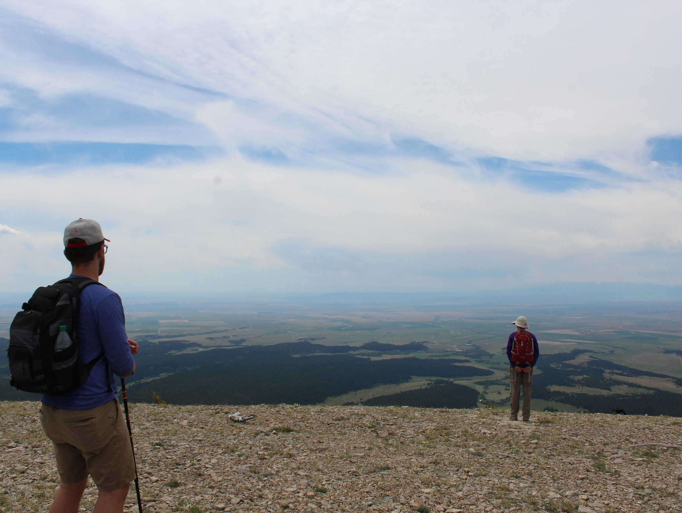 Hikers take in the views from the ridge of the Ice