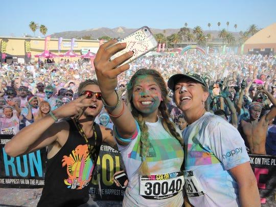 Participants in The Color Run in Ventura celebrate