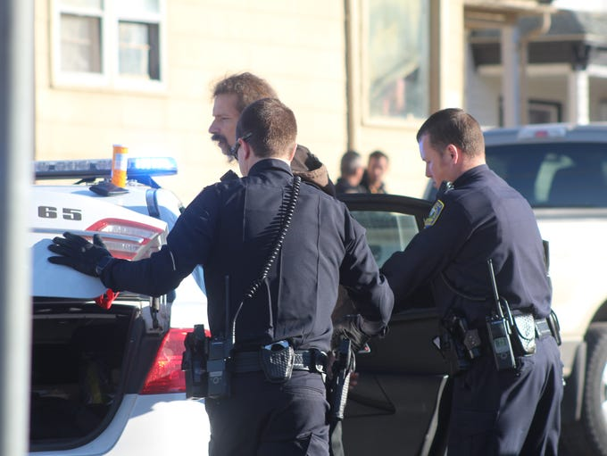 Great Falls police prepare to transport suspect following