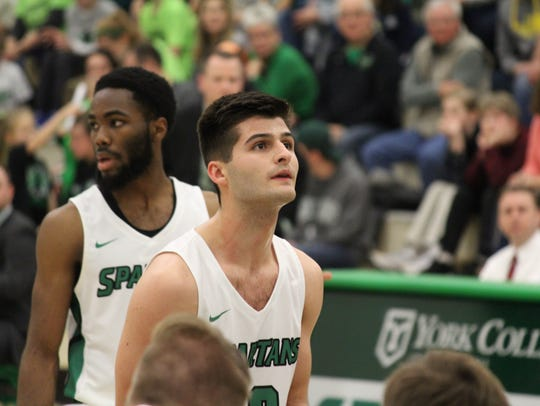 York College' Matt Scamuffo eyes up a free throw during