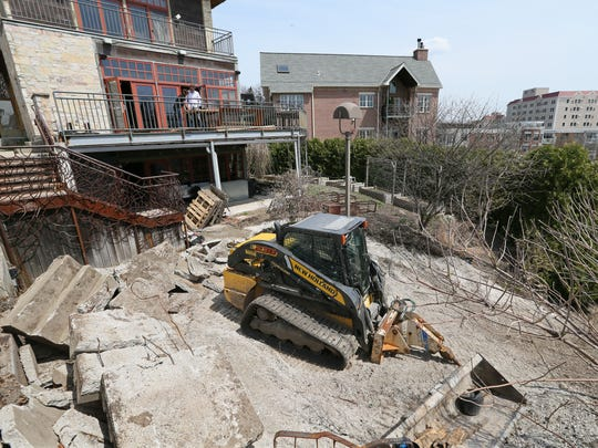 The outdoor produce garden at the former Wolf Peach restaurant is being replaced by an expanded patio by the building's new owner.