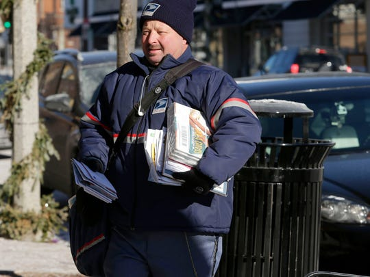 """You got to dress warm and just keep on moving,"" says Gary Szalewski, a U.S. Postal Service letter carrier, as he delivers mail in the cold along N. Downer Ave. near E. Belleview Place in Shorewood."