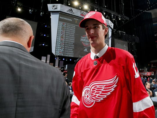 Keith Petruzzelli meets with executives after being selected 88th overall by the Detroit Red Wings during the 2017 NHL draft at the United Center on June 24, 2017 in Chicago.