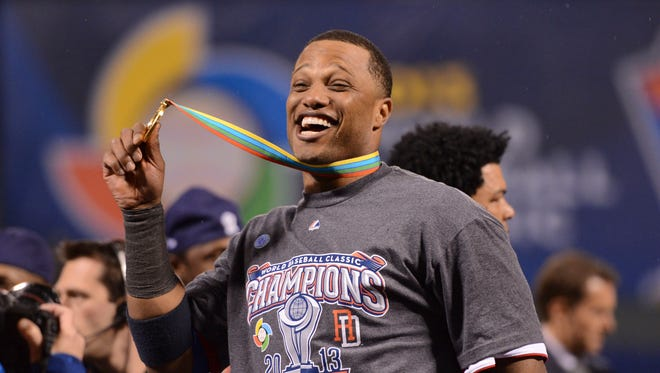 Second baseman Robinson Cano celebrates with his championship medal after the 2013 World Baseball Classic final against Puerto Rico at AT&T Park in San Francisco. Cano, the Seattle Mariners' star, was named the tournament's MVP as the Dominican Republic defeated Puerto Rico 3-0 for the title.