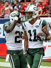 New York Jets wide receiver Robby Anderson (11) celebrates with running back Elijah McGuire after Anderson caught a 38-yard touchdown pass against the Tampa Bay Buccaneers during the second half of an NFL football game Sunday, Nov. 12, 2017, in Tampa, Fla. (AP Photo/Steve Nesius)