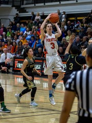 Freshman point guard Katie Campbell hangs in the air while attempting a shot during the Ventura College women's basketball team's 65-50 win over Los Angeles Valley in the CCCAA Southern California regional final at VC.