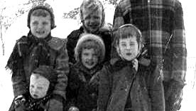 Joan Fitzgerald Hakes (front right) with some siblings on the farm near Gilmore City on a cold winter day in the 1950s.