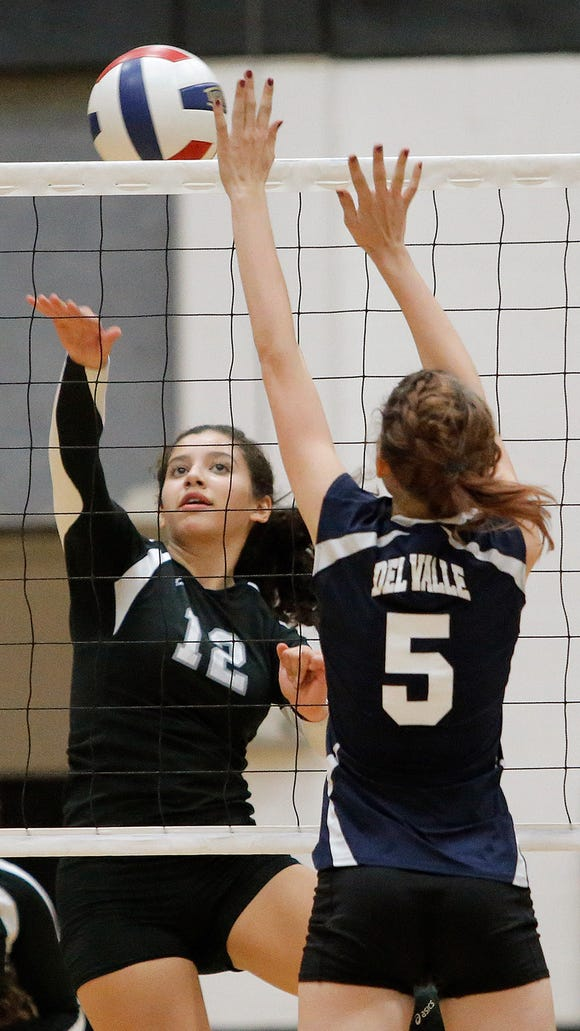 Hanks middle hitter Sandra Sierra hits around Del Valle middle blocker Alyssa Duncun in game two of their match Tuesday at Hanks High School. Hanks beat Del Valle 3-0.