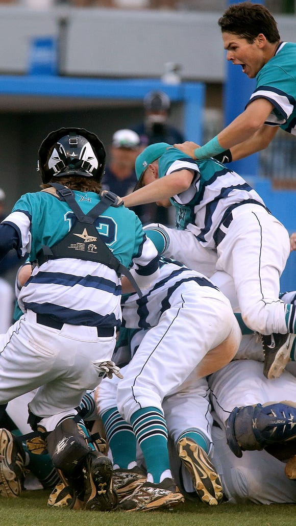 Siegel's short stop Drew Benefield (24) is on top of