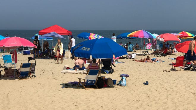 Umbrellas line Rehoboth Beach seen July 14, 2017.. Despite the ban enacted on May 15, a single canopy can be seen.