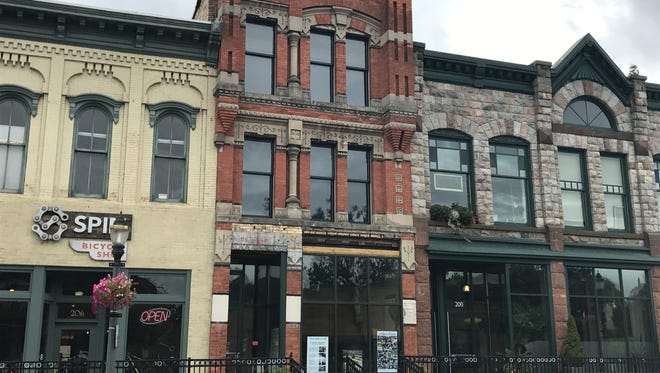 The three-story building at 204 E. Grand River Ave. will be renovated and turned into loft apartments.