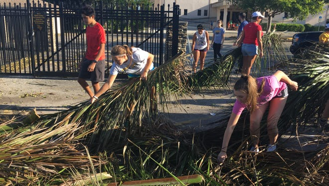 Cleanup efforts at Bishop Verot High School brought out hundreds of students, staff and community volunteers to return the Catholic school in Fort Myers to its pre-Hurricane Irma state Wednesday morning.